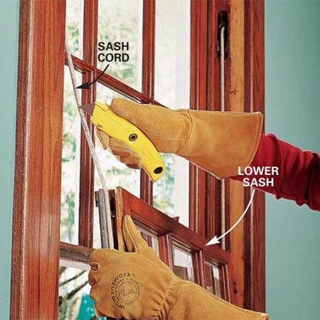 <b>Step 2: Remove the lower sash</b></br> Photo 2: Remove the lower sash and cut the sash cords. If your window has weatherstripping or hardware other than sash cords, pry out or unscrew these to remove the sash.