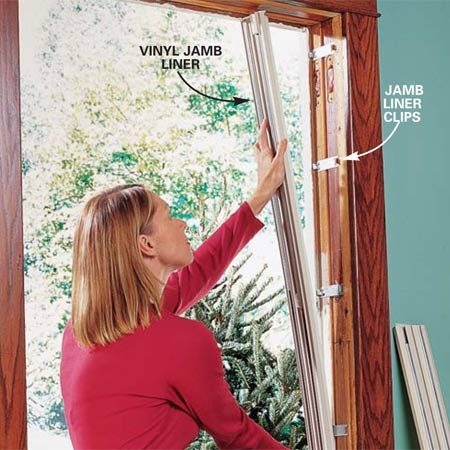 <b>Photo 5: Place jamb liners</b><br/>Snap jamb liners over the metal clips after installing the sash stops and gaskets according to the instructions included with your window. Align the jamb liner so its outside edge fits between the blind stop and the metal clips. If your jamb liner has a vinyl flap facing the outside, make sure it lays over the blind stop. Press firmly over each clip location until you hear or feel the liner snap onto the clips.