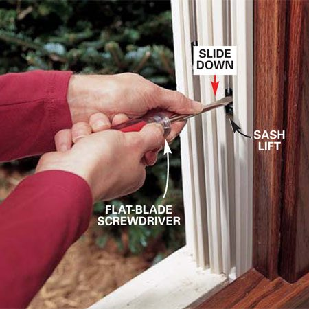 <b>Photo 7: Position the sash lifts</b><br/>Slide the sash lifts down to within about 10 in. of the windowsill. Press down firmly with a flat-blade screwdriver. Twist the screwdriver slightly from horizontal to slide the lifts. Then twist back to horizontal to engage the lifts in their new locations. <strong>Caution:</strong> Release pressure slowly to make sure the clips are engaged before you remove the screwdriver completely.