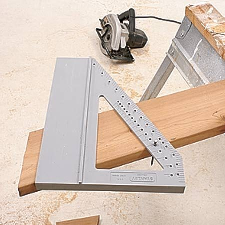 <b>Photo 2: The saw glide at an angle</b></br> Insert a nail to hold the glide at the desired roof slope (or other angle). Then make the cut.