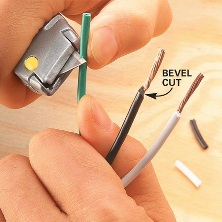 <b>Photo 4: Alternative knife method</b></br> Slice through the insulation at an angle all the way around the wire. Then twist and slide the insulation from the wire. Inspect the wires for nicks and gouges.