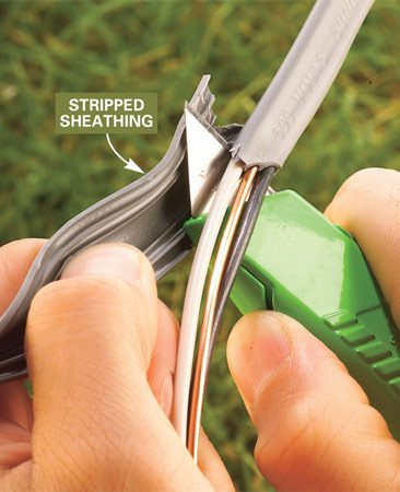 <b>Photo 3: Cut excess sheathing</b></br> Slide your knife between the loose sheathing and wires and cut toward the unstripped cable to remove the excess plastic sheathing.