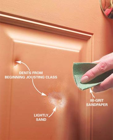 <b>Photo 1: Prepare the door</b></br> Scrub dirt off the door with detergent, then rinse and dry the area. Lightly sand the dented area with 80-grit sandpaper to help the patching compound bond, then wipe clean.