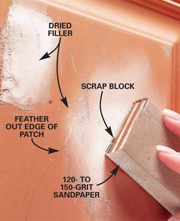 <b>Photo 3: Sand smooth</b></br> Sand the area flat after the filler dries using 120-grit sandpaper wrapped around a flat block. Switch to 150-grit sandpaper to smooth out the edges of the patch.