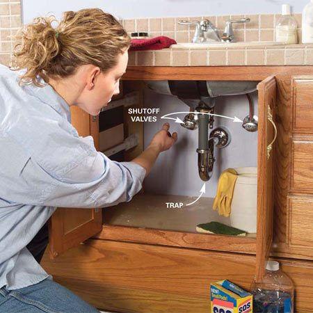 <b>Photo 1: Shut off the water </b></br> Shut off the water to your sink before you disconnect your faucet supply tubes. Look for shutoff valves under the sink and turn them off. If you don't have shutoff valves, shut off the water supply where it enters your house. Turn on the sink faucet to make sure the water is completely off.