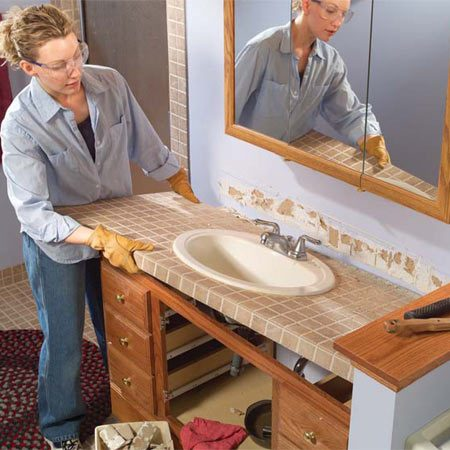 <b>Photo 5:</b></br> Pull the top free from the vanity and try to lift it straight out to minimize damage to the surrounding walls and fixtures. Get some help; it may be heavier than you think.