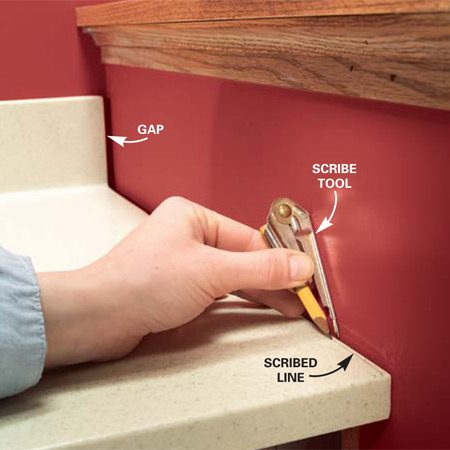 <b>Photo 15: Scribe the top to fit</b></br> Set the top onto the cabinet to check the fit. If an adjoining wall doesn't allow you to set the top flush, you may need to scribe it to fit. We needed to remove a small portion from the front to allow the backsplash to fit into the corner.