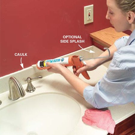 <b>Photo 20: Apply caulk</b></br> Caulk where the backsplash meets the wall with siliconized acrylic caulk and smooth the joint with a moist finger. Let the caulk dry and you're ready to use your new sink and vanity.