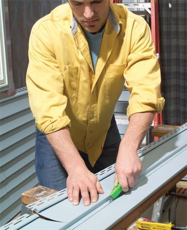 <b>Lead image</b></br> You'll need specialty tools, like this zip tool, to work with vinyl siding.
