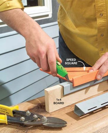 <b>Photo 6: Notch the J-channel</b></br> Cut a section of new J-channel 2 in. longer than the width of the window. Mark out a notch 1 in. in from each end and deeply score the inner cutting line with a utility knife.