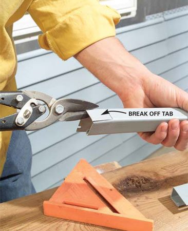 <b>Photo 7: Finish the notches with tin snips</b></br> Make the last two cuts with snips. Bend the tab back and forth to snap it off (see Photo 8).