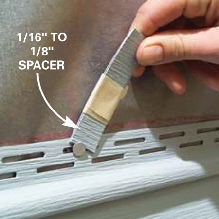 <b>Photo 14: Don't nail the siding tight against the wall</b></br> Drive nails so that the exposed shank equals the thickness of two layers of siding (1/16 in. to 1/8 in.). Don't drive nails all the way in.