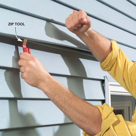 <b>Photo 16: Lock the siding together</b></br> Finally, pull the last loose piece down and over the lock with the zip tool. Using your hand, push or pound the piece to lock it back into place. Work the piece into the lock down its length.