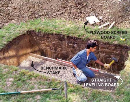 <b>Photo 2: Level the hole</b></br> Dig a hole about 4 in. deeper than your desired pond depth, then fill the bottom with 4 in. of gravel. Drive 2x2 stakes in the middle of the wall positions at each corner and drive them down slightly below the top of the gravel. Choose one of the stakes as your benchmark and level across to the tops of the other with a 4-ft. level and straight 2x4, driving them down until they're all even.
