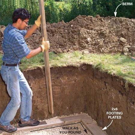 <b>Photo 4: Install the footing plates</b><br/>Cut the treated 2x6 footing plates to length, then lay them on the gravel and toenail the ends together with 16d nails. Stand on the footing plates and settle them into the gravel by pounding on them with another 2x6. Settle the entire perimeter by walking along it as you pound.