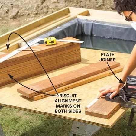<b>Photo 16: Cut biscuit slots in the decking</b><br/>Lay a 32-in. deck board in place (Photo 18). It should extend about 4 in. over the pond edge. Mark the board at the centers of the pond ledger, grade beams ledger and about 3 in. from the pond end. Use the board as a pattern to mark biscuit placement points on both edges of other deck boards. Cut No. 20 biscuit slots on the adjoining edges.