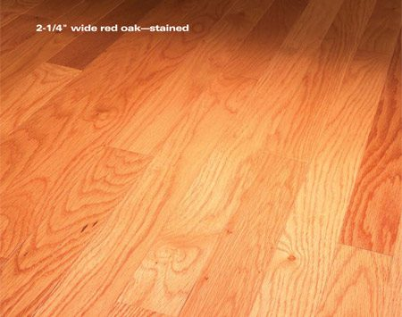 <b>Stained 2-1/4-in.-wide solid red oak flooring</b></br> A traditional solid wood floor has random butt joints, a variety of wood grain patterns and, often, slim cracks between strips during the dry season.