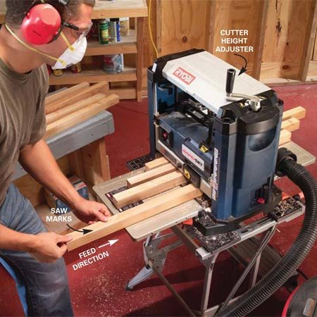 """<b>Gang-feed deck spindles</b></br> Remove saw marks from ripped 2x2s with a planer. Gang feeding like this speeds the work and reduces """"snipe"""" on the ends of boards."""