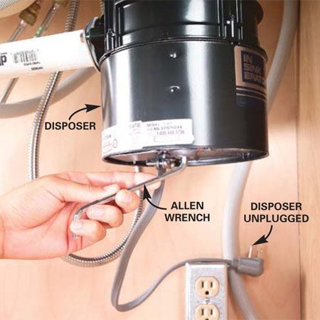 If the disposer hums but doesn't spin, try rotating the<br/> disposer blades manually.