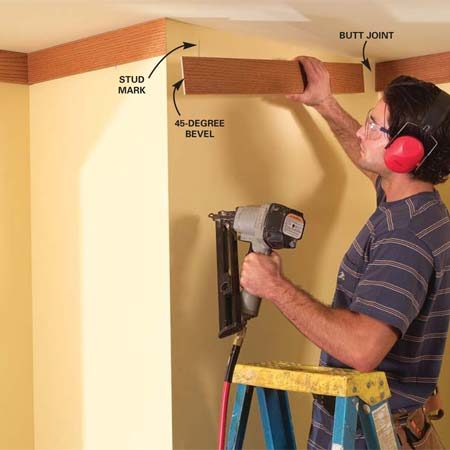 <b>Photo 10: Install the 1x4s</b></br> Mark the studs, then butt the 1x4s to the ceiling and nail them. Butt and scribe inside corners (see Photo 7) and miter outside corners.