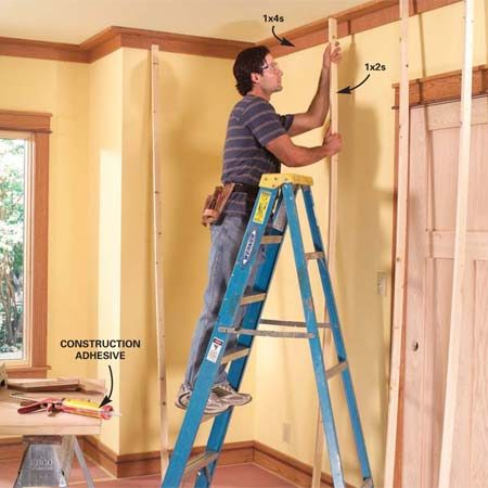<b>Photo 12: Use temporary braces</b></br> Along walls without ceiling framing, use construction adhesive and temporary braces to attach the boards.