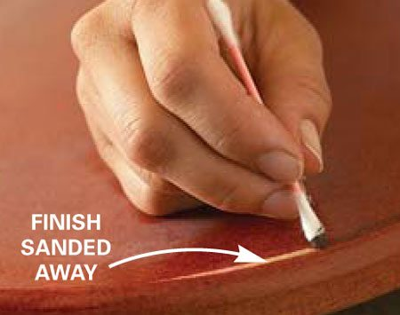 <b>Don't sand through the stain</b></br> When sanding between coats, it's easy to rub right through the clear coat, removing the stain below. So sand super lightly after the first coat, just enough to cut down any dust whiskers on the surface. If there are bigger problems—such as runs—deal with them after the second coat when you can sand a bit harder. To repair rubbed-through spots, just apply new stain. Immediately wipe away any stain that gets on the surrounding polyurethane.
