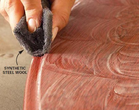 <b>Sand curves with pad</b></br> When sanding between coats, smooth curves with a steel wool substitute such as 3M's Scotchbrite pads. Steel wool leaves fibers behind, which can cause stains in the finish.