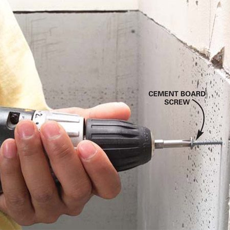 <b>Photo 2: Attach the cement board to the studs</b></br> Fasten the cement board to the studs with special 1-1/4 in. screws (or 1-1/2 in. roofing nails). Keep fasteners 1/2 in. from the edges, and install nailers in the corners if necessary to ensure adequate backing.