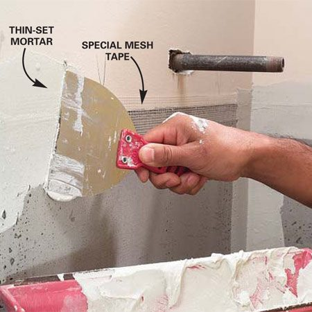 <b>Photo 4: Tape the joints</b><br/>Tape cement board joints with special mesh tape. Mix a batch of thin-set mortar and cover the tape with one thin coat.