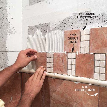 <b>Photo 12: Use spacers to create grout lines</b></br> Lay in the special feature tiles following layout lines. Use bigger spacers if the grout lines are wider, or tap in nails to keep small tiles from slipping.