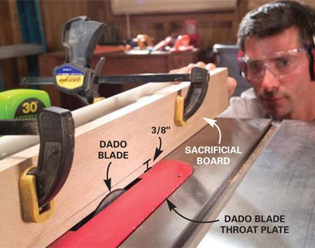 <b>Photo 4: Set up the dado blade</b></br> Mount a dado blade in the saw. Clamp a sacrificial board to the fence, start the saw and slowly raise the blade into the board until it's 3/8 in. above the saw table.