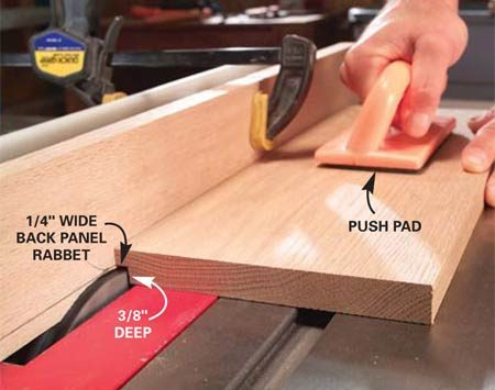 <b>Photo 5: Cut rabbets for the back panel</b></br> Readjust the fence to cut a 1/4-in. wide rabbet and cut the rabbets for the back panel into the side, top and bottom. Push down firmly with a push pad to make a smooth cut.