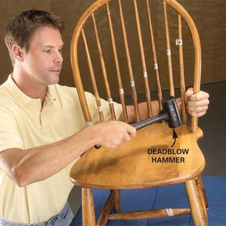 <b>Photo 2: Disassemble the back</b></br> Hold chair upright about 1/2 in. off a padded workbench. Firmly strike seat downward, near each joint, with a deadblow hammer.