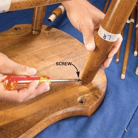 <b>Photo 3: Remove screws and nails</b></br> Examine the legs closely and remove all screws and nails before hammering the legs apart. Save the screws for reassembly.