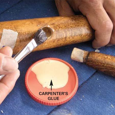 <b>Photo 7: Apply new glue</b></br> Apply a light coating of yellow carpenter's glue to the seat and leg joints. Coat mortise holes using a small brush. Reassemble quickly.
