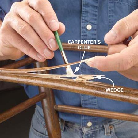 <b>Photo 1: Apply glue to the split</b></br> Wedge open a split rung with a wood wedge. Apply carpenter's glue to split pieces using a small brush.