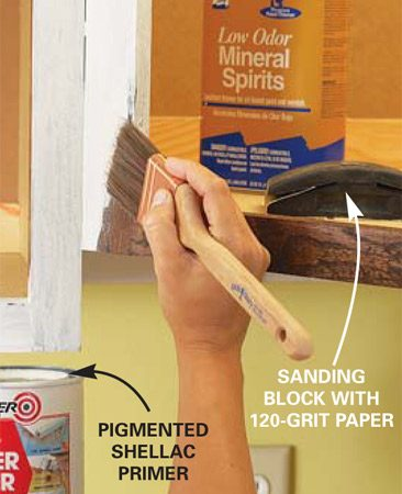 <b>Photo 1: Prep before painting</b></br> Clean the cabinet face frames with mineral spirits, then scrub them with household ammonia and rinse. Fill holes with spackling compound, then sand with 120-grit sandpaper. Vacuum the cabinets, then prime them with a pigmented shellac. Lightly sand the dried primer.
