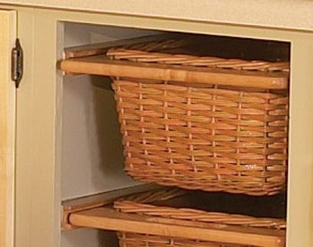 <b>Photo 3: Open basket unit results</b></br> Open baskets break up the solid bank of base cabinet fronts and make the kitchen feel more spacious.