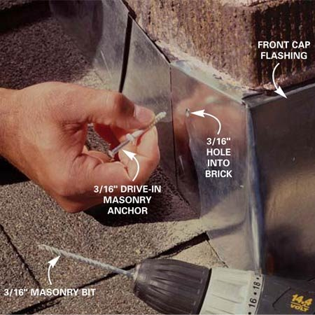 <b>Photo 10: Secure the flashing</b></br> Drill a 3/16-in. x 1-1/2 in.-deep hole through the metal and into the bricks on each corner of the chimney. Then press the expanding plastic anchors into the holes and pound in the protruding nail to expand the anchor and secure the flashing.