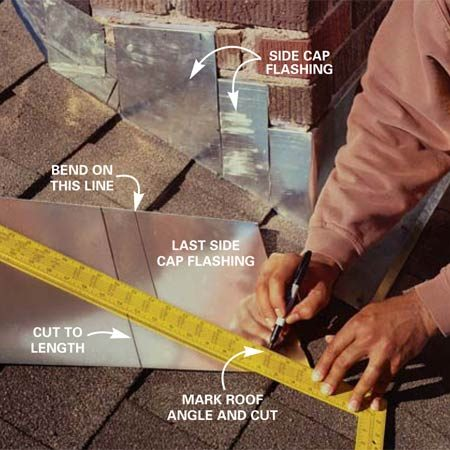 <b>Photo 11: Continue to install cap flashing</b></br> Cut the side cap flashing to fit the angle of the roof so it overlaps each lower cap flashing at least 2 in. Pound the flashing into the grooves and fasten with the drive-in expanding anchors. Bend a piece of cap flashing to fit around the top corner of the chimney and add the cap flashing across the back of the chimney.