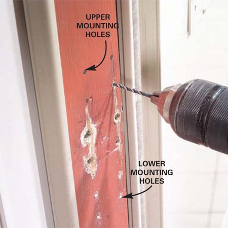 <b>Photo 3: Drill mounting holes</b></br> Drill the upper and lower mounting holes with a 3/32-in. drill bit.