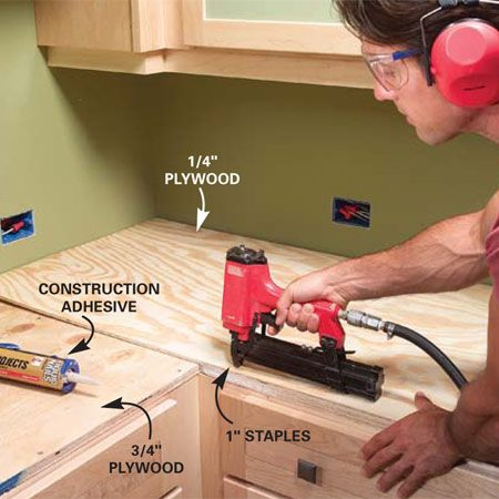 <b>Photo 3: Install a second layer of plywood</b></br> Glue and staple another layer of plywood (1/4 in.) over the 3/4-in. plywood if necessary to build up the thickness to match the edge tile.