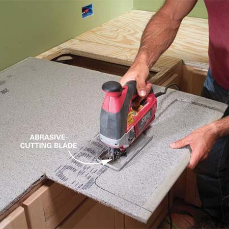 <b>Photo 6: Use a jigsaw to cut the cement board</b></br> Cut the cement board with your jigsaw outfitted with an abrasive-cutting blade.