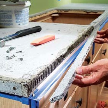 <b>Photo 8: Install cement board along the counter edges</b></br> Score and snap thin strips of cement board and embed them into thin-set mortar along the edges. Nail the strips with 1-1/4 in. galvanized nails.