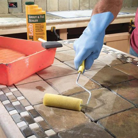 <b>Photo 14: Seal stone before grouting</b></br> Coat the face of the porous tile and stone with a sealer before grouting to prevent the grout from sticking to the tile surface.
