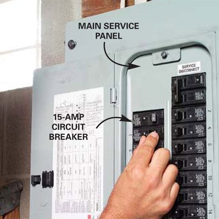 <b>Photo 1: Locate a power source</b></br> Find a nearby outlet in the wall opposite the back side of the cabinets and plug in a radio (right). Find the circuit by turning off circuit breakers until the radio goes off.