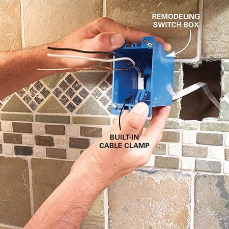 <b>Photo 12: Mount the box</b></br> Push the cable into a remodeling box and mount it in the wall.