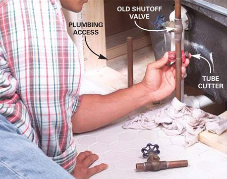 <b>Photo 1: Replace leaky shutoff valves</b></br> Turn off the water to the house at the main valve and replace old, leaky shutoffs. Cut the old valve out with a close-quarters tube cutter.