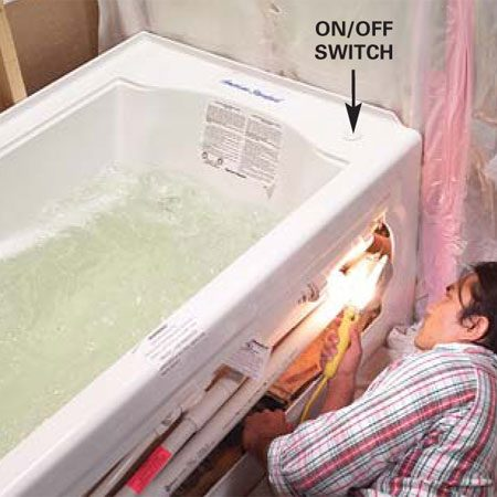 <b>Photo 15: Test for leaks</b></br> Check the drain for leaks, then fill the tub, plug the motor in, and turn the whirlpool on. Carefully check all the pipes and joints for leaks.