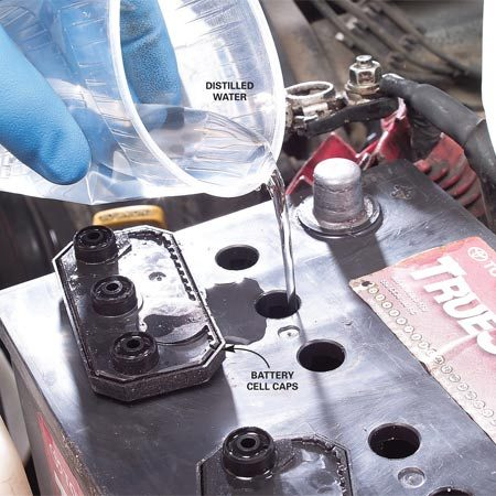 <b>Add water to fill holes, if necessary</b></br> If the battery needs water, use clean, distilled water and don't over fill the cells.